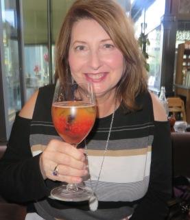 drinking a Peche Mignon